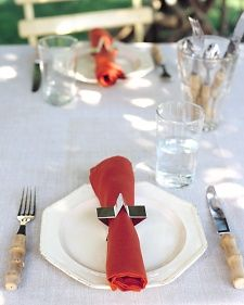 Use seasonal cookie cutters as napkin rings - could also send home as a favor!