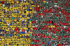 A World Cup in Brazil was always going to mean one thing: colour. This shot makes the most of it, exploiting the divide between the two sets of fans from Brazil and Mexico during their group encounter. It's a simple, long-lens shot made by a photographer who knew the value in turning his attention away from the pitch