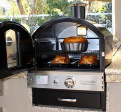 Pacific Living PL8BLK Counter Propane Black Outdoor Pizza Oven Pizza delivery? We think not... This incredible outdoor countertop/built-in gas oven will add versatility to your backyard, allowing you