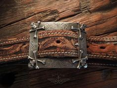 Iron Crow Rockin Vintage - Be A Rock Star! Bitchin! Douglas Magnus Skullbones Sterling silver belt buckle with vintage tooled leather belt, $297.00 (http://www.ironcrowvintage.com/products/be-a-rock-star-bitchin-douglas-magnus-skullbones-sterling-silver-belt-buckle-with-vintage-tooled-leather-belt.html)