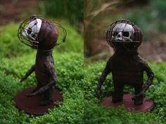 cute and creepy like a little Tim Burton character