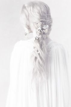 Then he saw it; a clear image of Anala. In all this brightness, there she stood all in white with her grey hair falling past her shoulders. He felt his eyes relax from all the squinting and the glaring. It was as if the light is comforting him.