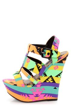 Check it out from Lulus.com! Electrify your outfit with the neon nuances of the Dollhouse Electric Black Multi Neon Print Platform Wedges! There's nothing subtle about these showstopping sandals, with a multicolored neon Southwest print that rocks a modified, quadruple T-strap from open toe to quarter strap. Fastens with a shiny black buckle and matching grommets (with hidden elastic). Fabric wrapped platform builds from 2