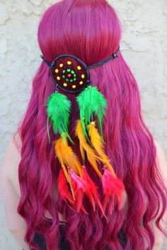 """Stunning rasta dreamcatcher headband with feathers in red, yellow and green. This unique handmade dreamcatcher features a 3"""" ring (in diameter) with wooden beads in the center. Ring is attached to a s"""