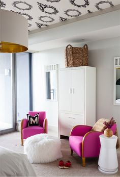 An elegant use of pink and black for a girl's room.