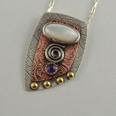 Mother of Pearl Pendant - Artisan Metal Jewelry - Textured Metal Necklace by DeborahCloseDesigns on Etsy https://www.etsy.com/listing/168748396/mother-of-pearl-pendant-artisan-metal