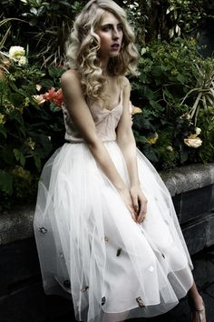 LOve the CURL in the this hair STYLE  and                                                                                                  the Beaded tulle skirt via designlovefest