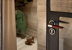 House of Eroju - Moscow Leather Lever Handle - Moscow Lever Leather Handle on Door