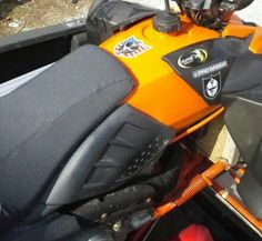Upholstered my seat with marine grade high traction vynl. And painted the gas tank to match the front nose