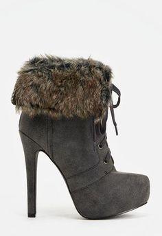 Cette paire de bottines à lacets aux talons hauts est ultra cool et confortable !...