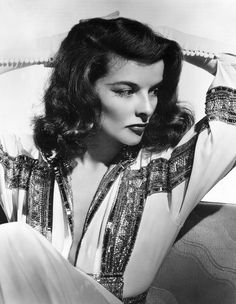 Katherine Hepburn: dramatic cat eyes, elegant full length and flowy frocks with often plunging necklines, sequins, loosely curled cropped hair, minimal jewelery...