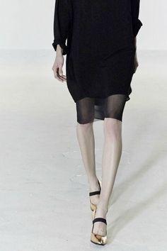 black dress golden shoes