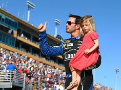 Jimmie Johnson and daughter Genevieve Johnson prior to the Ford EcoBoost 400 at Homestead-Miami Speedway.  11/17/2013