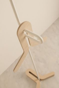 HC Hanger is a minimalist design created by Japan-based designer Yasutoshi Mifune. It is a coat hanger whose base part can store hangers by stacking them. The shape of hangers is good for hanging high-collared clothes. The base is manufactured in wood, while the rest of the hanger is bent metal. The thin white structure resembles a sculpture of sorts. (1)
