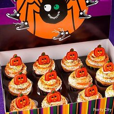 Use a cute display box that doubles as a cupcake display to make cupcakes easy to carry and transport. #partycity #halloween