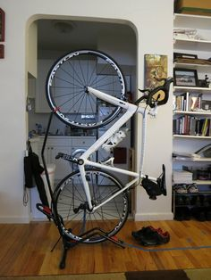 A no-drilling, free-standing, vertical bike stand perfect for small living spaces--the Minoura DS-2100