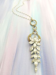 """Joy in the Morning"" - Antique brass crescent layered under an antique rhinestone flower pendant on pyrite beaded chain"