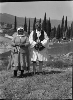 """Droukas + wife Creator: """"Thompson Homer A."""" Publisher: """"Blegen Library Archives"""" Date: F Coverage: """"Greece, Saronic Islands, Poros"""" American School of Classical Studies at Athens, Homer A. Greek Traditional Dress, Greek Independence, Greece Map, Greek Culture, Folk Costume, Athens, Old Photos, The Past, Istanbul"""