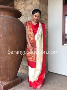 Silk Tant Saree in Off White and Red This drape from Bengal Handloom is woven in Zari and Resham Available with an Unstitched Cotton blouse. Do note: Blouse and Accessories shown in the image are for presentation purposes only.(Slight variation in actual color vs. image is possible).