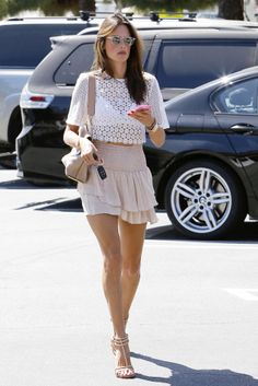 Alessandra Ambrosio in white cropped top and nude skirt - summer style