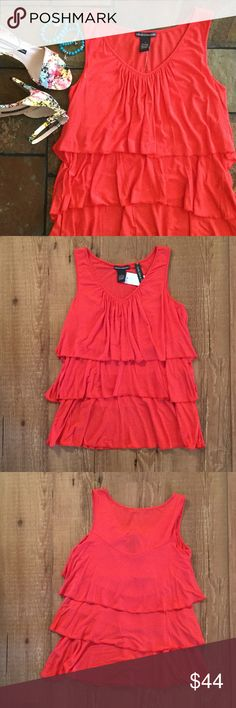 """Orange v-neck tiered top A sunset orange color, v-neck, 3 tiers, sleeveless. 95% rayon, 5% spandex. Bust (laying flat) 16"""". Length 24 1/4"""". Please ask any necessary questions prior to purchasing. No trades. Save even more with a bundle discount! Chelsea and Theodore Tops"""