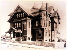 Exterior front corner view of the Leonard John Rose Victorian home at  400 South Grand Avenue, Los Angeles, in 1888. Rose was a San Gabriel  Valley rancher at Sunny Slope at Santa Anita, with success in fruit  growing, olive oil and wine making, and horse breeding. He left the  ranch to live in the Grand Avenue house when it was completed.