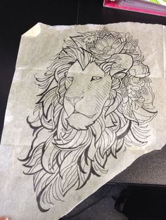 Pleased uncolored lion head decorated with flowers tattoo design ...