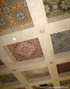 Assorted tiles with SkimStone and Modello® stencil treatments applied to Roclon Canvas and wallpaper pasted to a coffered ceiling in our Royal Design Studio..