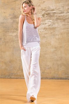 Wide legged white linen pants with black and white striped top ...
