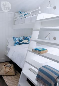 Cottage bedroom: A cottage bedroom features two twin-over-double bunk beds to accommodate more guests {PHOTO: Robin Stubbert} #beachcottagestyleloft