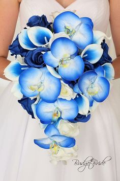 Stunning horizon blue bouquet with orchids and royal blue halo calla lilies