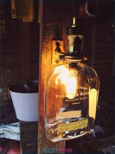Upcycled Woodford Reserve Bourbon Whiskey Bottle Lamp sold by Thrifty Twins. Shop more products from Thrifty Twins on Storenvy, the home of independent small businesses all over the world. Industrial Wall Lights, Industrial Style Lighting, Unique Lighting, Bar Lighting, Outdoor Lighting, Diy Bottle Lamp, Bottle Art, Liquor Bottles, Glass Bottles