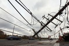 MASSAPEQUA PARK, NY - NOVEMBER 01: Cars move past downed power wires on Sunrise Highway on November 1, 2012 in Massapequa Park, New York. Superstorm Sandy, which has left millions without power or water, continues to effect business and daily life throughout much of the eastern seaboard. Photo: Bruce Bennett, Getty Images / 2012 Getty Images