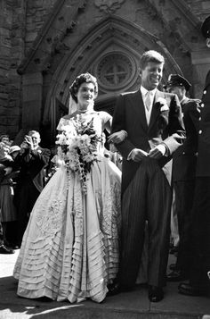 Jacqueline Bouvier in gorgeous Battenburg wedding dress w. her husband Sen. John Kennedy as they stand in front of church after wedding ceremony. (Photo by Lisa Larsen//Time Life Pictures/Getty Images)