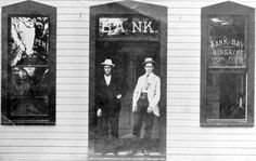 Men standing in the entrance to the Bank of Bay Biscayne - Miami, Florida: One of the men is Richard Brown, President of the bank (1896)