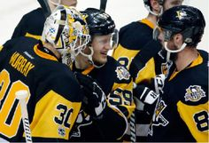 Pittsburgh Penguins' Matt Murray, left, Jake Guentzel, center, and Brian Dumoulin celebrate after the Penguins defeated the Nashville Predators 4-1 in Game 2 of the NHL hockey Stanley Cup Final, Wednesday, May 31, 2017, in Pittsburgh. (AP Photo/Gene J. Puskar)