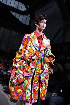 Rei Kawakubo interpreted Dan Michiels tesselated patterns into generous rosettes, folds and pleats and bunching up of fabric that leaves the result joyful and explosive.