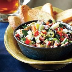 Muffuletta Dip - This dip version of the classic New Orleans sandwich features olive salad, salami, pepperoncini salad peppers, black olives and diced provolone cheese. Serve with slices of French bread for a hearty tailgate treat.