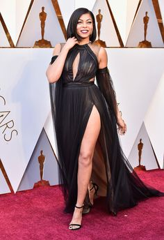 Taraji P. Henson wore a custom Vera Wang black hand-draped french tulle gown with draped sleeves and a high slit to the 2018 Oscars.