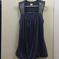 Gray beaded tank top Never been worn. Gray tank top with beaded straps. Elastic on the bottom to give the tank a great shape! Tops Tank Tops