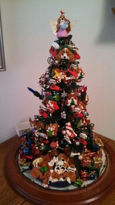Basset Tree. Sculpted after each of my bassets.