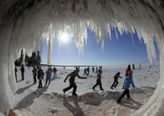 Sightseers look at icicles at the mouth of a sea cave of the Apostle Islands National Lakeshore of Lake Superior near Cornucopia, Wisconsin February 14, 2014. According to the National Oceanic and Atmospheric Administration (NOAA) Great Lakes Environmental Research Laboratory, about 94% of Lake Superior is covered with ice, enabling thousands of people to visit the islands on foot for the first time since 2009. The Great Lakes, which contain one fifth of the world's surface fresh water, are…
