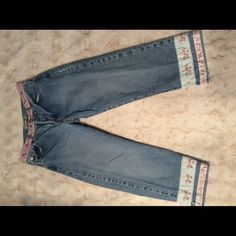 London Jean button fly capri With ribbon trim, these capris are so cute and feminine. London Jean Shorts Jean Shorts