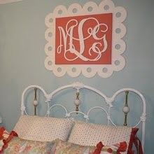 This monogram was painted, mounted on a painted canvas and framed with a decorative board.