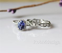 Hey, I found this really awesome Etsy listing at https://www.etsy.com/listing/247228374/2pcs-tanzanite-engagement-ring-set-14k