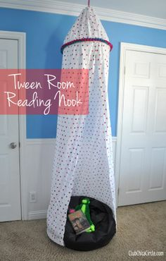 Tween Room Decor Reading Nook DIY - use a flat twin sheet and a large embroidery hoop to create this cool reading canopy. For my daughter's reading corner. She thinks she's to old to cuddle with mum, but at least she can be cozy! Can you tell I love the cozy? :)  #PrimroseReadingCorner