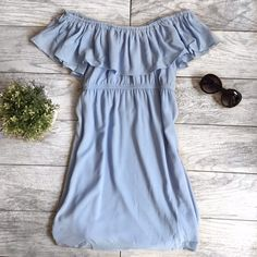 Blue Ruffle Dress New! Fits true to size! Is so cute and the prettiest blue we have ever seen Dresses