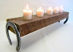 Rustic horseshoe candle holder with 5 tea candle glasses. Horseshoes can be painted or left rustic.