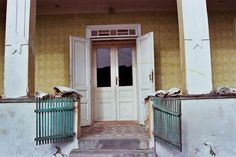 The double doors and double gates with peeling paint. Beyond France's Hungarian home and world of inspiration