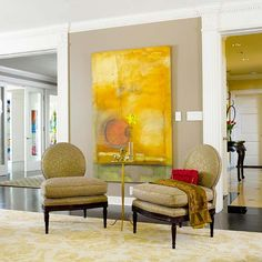 In this formal living room, the entryways are flanked by fluted columns and rich millwork for dramatic effect. Both are features normally found on the exteriors of classic homes, but they're equally comfortable imparting architectural presence to an interior. Such a treatment requires a substantial space, however. The lower the room's ceiling, the more subtle the molding treatment should be.